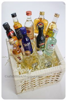 Mini bottles of Liquor arranged in a basket. Great gift for 21st Birthday, Father's Day, Christmas, Party, etc.