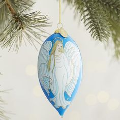 Capture the joy of the season with a beautiful angel, depicted here on one of our exclusive Li Bien ornaments. Artists insert an L-shaped brush through a small opening and reverse paint the image by hand. Each ornament features a new design, is dated for collectibility and comes with its own gift box.