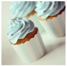 Blue frosting cupcake design for baby shower..love the cups.