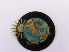 Vintage Cosmic brooch on ebay $9.99