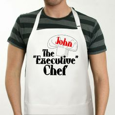 "#FathersDay Personalized Executive Chef Aprons. Your Executive Chef is going to look great in this Personalized Executive Chef Aprons. Let the slicing & dicing begin and be sure to thank the Chef for this wonderful meal. Our Personalized Executive Chef Aprons is a white full length, 65/35 cotton/poly twill fabric apron with adjustable neck and matching fabric ties. Machine washable. This custom bib apron measures 28"" x 30"" and features 3 center pockets for convenient storage."