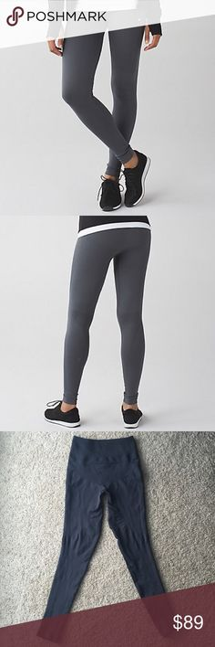 Lululemon zone in tight compression full length! These high rise babies suck you in and hold you in! Love them! They are a tighter fit than most Lulu pants. Fabric is four way stretch. Has black logo on back of leg. 88% nylon, 12% elastane. Still on the website, but sold out. Color is dark slate, almost black. Perfect condition! lululemon athletica Pants Leggings