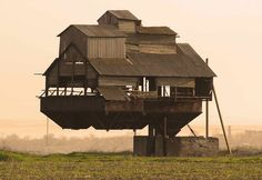 The floating farmhouse, from Atlas Obscura's 7 Buildings That Defy the Laws of Physics.