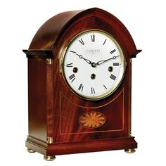 Inlaid Mahogany Lancet Mantel Clock. The clock has an eight-day movement with Westminster chime, sequence correction and chime silencer.