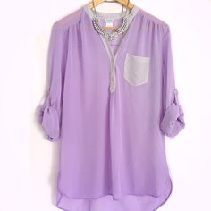 Sheer Lavender Popover Top EUC. Sheer lavender colored top with grey accents. Buttons down half way, popover style top. Roll sleeves. A bit long, almost like a tunic. Absolutely beautiful purple blouse. Size medium. Brand: Charming Charlie.   ❎No trades  ✅Offers considered through the offer button Charming Charlie Tops Blouses