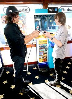 Norman Reedus and Chandler Riggs at The Nintendo Lounge. SDCC 2015