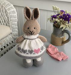This little dress was knit with a cast on of 96 stitches. To make the three row garter ridge hem, I cast on and knit 4 garter rows on straight needles before knitting in the round beginning with t.Ravelry: Project Gallery for Seasonal dresses Pattern Knitted Bunnies, Knitted Animals, Crochet Bunny, Crochet Toys, Knitted Doll Patterns, Animal Knitting Patterns, Knitted Dolls, Knitting For Kids, Free Knitting