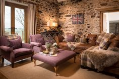 Caspian Ranch large luxury self-catering in Somerset near the Devon border with huge centrepiece fireplace and stables
