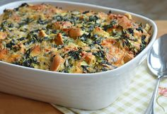 This elegant brunch strata — really a savory bread pudding with spinach, cheese and cubes of bread baked in custard — is perfect for entertaining. You do all of the preparation the night before and let it rest in the fridge overnight. The next morning you simply turn the oven on, place the strata in, and effortlessly wait for your brunch to emerge. It's a 'wow' dish so you can keep …
