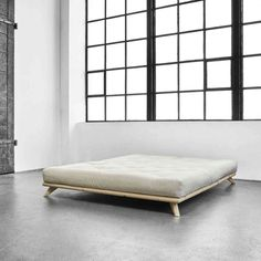 It is a multi-position futon that can be converted into a lounger or a bed with one simple push or pull. It promises to add comfort and style to any living room decor. Log Cabin Furniture, Dining Room Furniture, Furniture Design, Minimal Bed Frame, Futon Bed Frames, Style Japonais, Asian Home Decor, Futons, Best Mattress