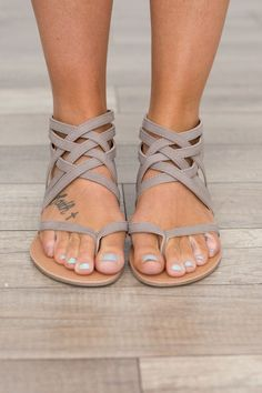 Want In black, brown or navy!!! Strapy front flat sandals with a zipper back closure. Man made material. Fits true to size. Sizes 5.5-10. Style #SATHENA-566TAUPE