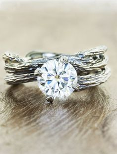 Nature-inspired engagement ring by Ken & Dana Design. Shown with the Willow wedding band.