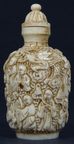 CHINESE CARVED IVORY 1000 FACES SNUFF BOTTLE