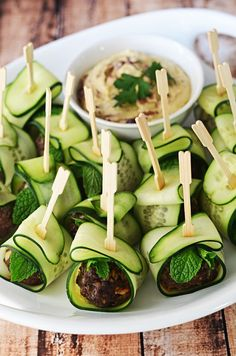 Cucumber Wrapped, Feta Stuffed Meatballs.  These Mediterranean-inspired meatballs are a HIT as an appetizer, and they're healthier than the usual options!  Served with hummus or tzatziki, they are perfect for parties!  | hostthetoast.com Rockwell Catering and Events