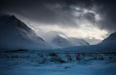 Glen Etive as a snowstorm passes through the glen in the Highlands.