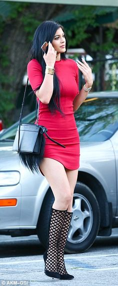 Kylie Jenner, 17, teams tight red dress with lattice-style heels #dailymail