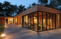 House of wood and glass in Sweden by Johan Sundberg. Situated in a forest, these are great reference photos for how wood and glass look at day and dusk, inside and out. Photography by Henrik Magnusson original post Bergman – Werntoft House / Johan Sundberg at archdaily
