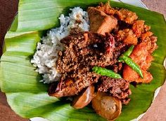 Gudeg is a traditional food from Yogyakarta and Central Java, Indonesia which is made from young Nangka (jack fruit) boiled for several hours with palm sugar, and coconut milk. Additional spices include garlic, shallot, candlenut, coriander seed, galangal, bay leaves, and teak leaves, the latter giving a reddish brown color to the dish. It is also called Green Jack Fruit Sweet Stew.