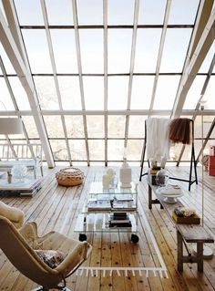 Attic space. Love the idea of using natural light. Night view must be amazing.