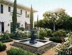 Possible planting scheme around fountain... succulents won't survive here, except Sempervivums!