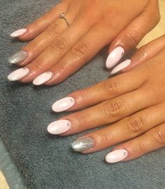 Shell pink oval nails, with neat silver glitter accents on ring fingers, and diamanté accented lunulas