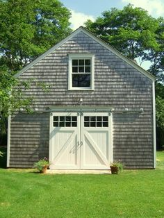 Exterior Door for garage idea. Hamptons style barn in Long Island, NY by Neff Architecture