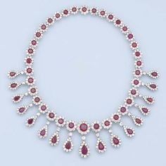 A VERY FINE ANTIQUE RUBY AND DIAMOND NECKLACE. Designed as 36 circular-cut…