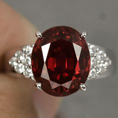 A Natural 6.97CT Oval Cut Red Garnet with Round Diamond Cut White Sapphire Accent Engagement Anniversary Promise Ring Size 6