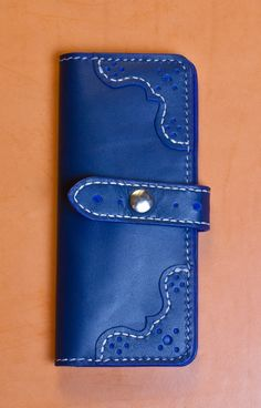 This is a brogue styled ladies wallet made by me.  The wallet is all hand cut, hand stitched and hand finished.  The leather is a Horween Lapis Cavalier.