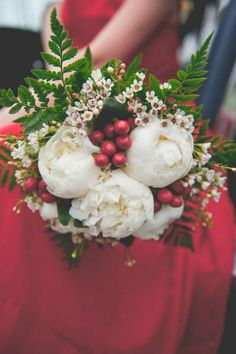 winter wedding bouquet filled with white peonies