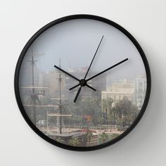 """""""Misty Alicante""""   Available in natural wood, black or white frames, $30.00 - our 10"""" diameter unique Wall Clocks feature a high-impact plexiglass crystal face and a backside hook for easy hanging. Choose black or white hands to match your wall clock frame and art design choice. Clock sits 1.75"""" deep and requires 1 AA battery (not included). #clock #wall #alicante #homedecor #ship #spain #city"""