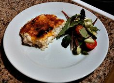 Chicken au gratin - plated and served with a salad.
