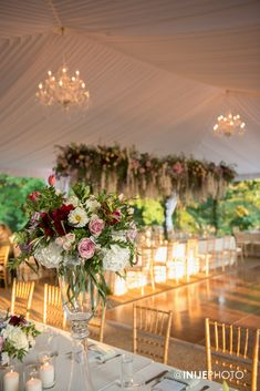 Wedding reception featuring tall garden centerpieces of roses, burgundy tulips, lavender, white & burgundy dahlias, and dusty miller and floral arbor over head table designed by Edge Design Group Wedding Reception Design, Wedding Designs, White Burgundy, Outdoor Tent Wedding, Outdoor Weddings, Midsummer Nights Dream, Atlanta Wedding, Edge Design, Wedding Colors