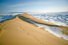 Gobi Desert- Giant waves of sand and ice stand frozen in place in the Khongorin Els Sand Dune in Mongolia. The dunes change size and shape each summer under blistering winds, with the highest dune recorded at approximately 800 meters (2,600 feet).