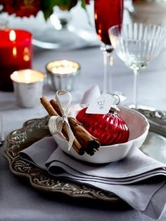 ~ Christmas ~ Love the Idea of an Ornament w/ Name for Place Card & Cinnamon Sticks....Great Idea for take home gifts after the evening's celebration....