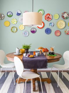 A collection of plates makes for colorful breakfast nook art #hgtvmagazine // http://www.hgtv.com/design/decorating/design-101/the-right-way-to-decorate-with-gray-pictures?soc=pinterest