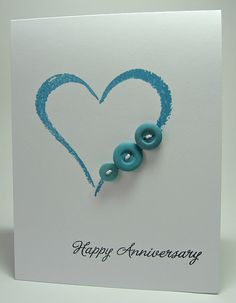 anniversary card for parents with 2 more hearts and adjoining hearts and buttons for the grandchildren.