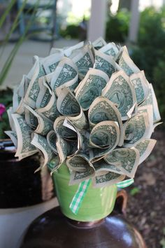 I made this Money Arrangment for my son's 1st grade teacher this year. It's the right size and color and simple to make. You just need a cute pot, a piece of Styrofoam and floral pins. Believe it or not this arrangement held 70 - one dollar bills. Thanks for looking.