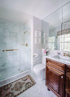 Bathroom design with glass shower door and chevron tiled floor | Alison Giese Interiors