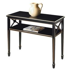 Hand-painted poplar wood console with gold trim.   Product: Console tableConstruction Material: Hardwood...