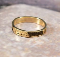 Rendered in a 10K yellow gold with engraved front and side elements, this wonderful antique Victorian mourning jewelry band ring is a sentimental beauty. The table worked hair braid is done with a dark brown hair and held in place on the gold band with gold sections on the quarters. Engraved in the front N. Morris, the ring is a wonderful piece of memento mori jewelry! Not all braided hair jewelry was for mourning... Antique Victorian Gold Woven Hair Band Ring Mourning Jewelry - Boylerpf - 2