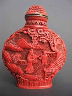 Chinese snuff bottle carved from cinnabar...because snorting a powder stored in a bottle made from mercury sulfide is SOOOOOO smart... Great craftsmanship though.