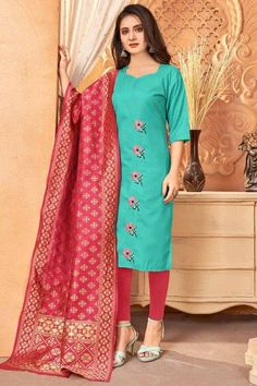 A stylish interpretation of ethnic glamour and contemporary style, this turquoise blue cotton trouser suit will make you absolutely classy. This sweetheart neckline and 3/4th sleeve outfit accentuated with thread work. Presented with cotton cigarette pants in cerise pink color and cerise pink banarasi silk dupatta. Cigarette pant is plain. #trousersuit #salwarkameez #malaysia #Indianwear #Indiandresses #andaazfashion