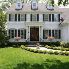 Colonial with portico and curved hand rails