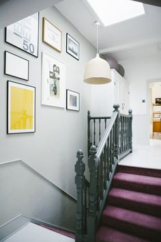 Stairwell with large scaled framed artwork, Down Pipe and Lamp Room Gray by Farrow & Ball in Victorian house renovation by Imperfect Interiors, Beth Dadswell, London, Photography by Leanne Dixon | Remodelista