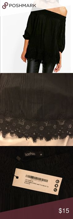 Black Pleated Lace Off Shoulder Top Black pleated chiffon lace off the shoulder top. Crochet lace detailing. Elastic three quarter length sleeve. Never worn. New with tags. Size medium, but runs large 100% polyester. Boohoo Tops Blouses