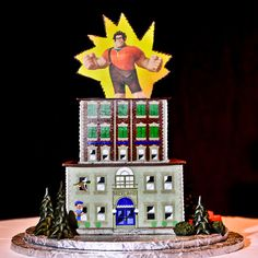 """This two tier Wreck-It Ralph groom's cake looks so delicious the couple may have to enlist """"Fix-It Felix"""" to help them finish the job."""