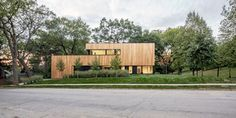 White finishes and oak panelling warm winter light in Minnesota home by D/O Studio