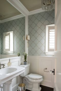 wallpapered powder bath by Studio M Interiors