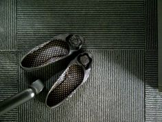 shoes | black | flooring | carpet | chairlegs